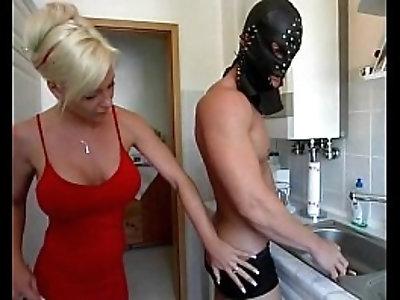 Dominatrix sexy busty blonde amateur milf having fun in the kitchen