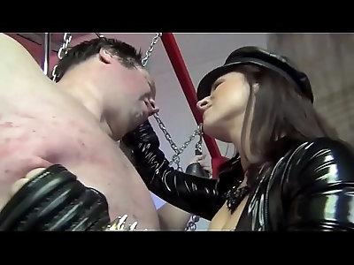 Face Slapped Bit By PVC Clad Mistress