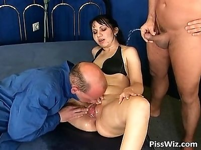 Some crazy slut enjoys dick and hot piss