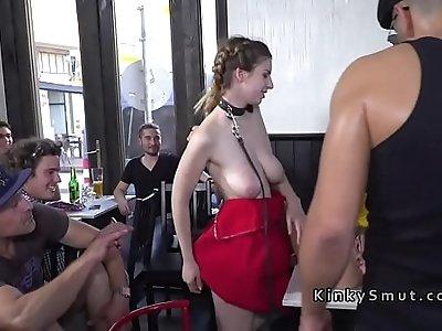 Busty bare boobs slave deep throats in public